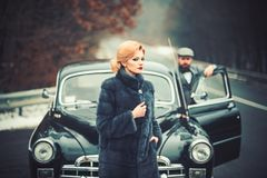 Nostalgia concept. nostalgia and retro car at bearded man and woman in coat. royalty free stock photography