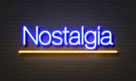 Nostalgia neon sign on brick wall background. Royalty Free Stock Photos