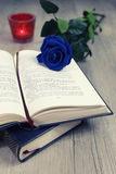 Nostalgia: Old book in French and blue rose Royalty Free Stock Image