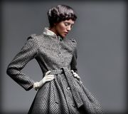 Nostalgia. Romantic Lady in Classic Coat Daydreaming. Pinup Style Stock Photos