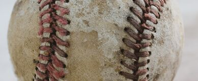 Old baseball texture of leather close up.