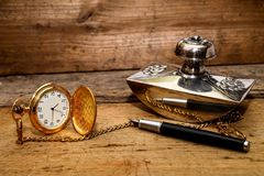 Nostalgia - Watch and pen. Pocket watch - elegance Royalty Free Stock Images