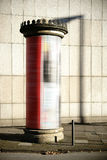Nostalgic advertising column with lantern shadow Stock Photos