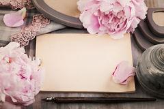 Nostalgic Background with Paper, Spring Flowers and Pen on Woode Stock Photo