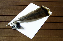 The nostalgic bird feather pen and paper. Nostalgic pens, write letters, calligraphy pens, pens for birds, write white pages and letters Stock Photo