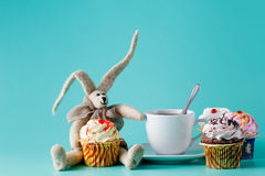 Nostalgic breakfast concept. Rabbit doll with cup of coffee Royalty Free Stock Photography