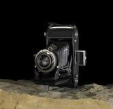 Nostalgic camera on stone surface Royalty Free Stock Images