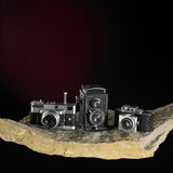 Nostalgic cameras on stone surface Stock Photo