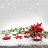 Nostalgic christmas decoration with antique baby shoe. S. festive background. retro style picture with snow effect stock photo