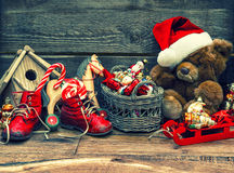 Nostalgic christmas decoration with antique toys. Over wooden background. vintage style toned picture royalty free stock images