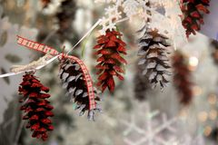 Old fashioned Christmas tree with pine cone ornaments that bring back childhood memories. Nostalgic Christmas tree with string of pine cones ornaments and ribbon Royalty Free Stock Photography