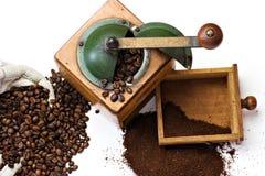 Nostalgic coffee mill. Coffee mill, whole beans, ground coffee Royalty Free Stock Photo