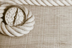 Nostalgic compass and rope. Nostalgic rustic wood background with compass and rope stock photos