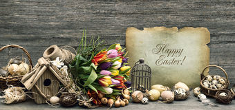 Nostalgic easter decoration, eggs, tulip flowers Royalty Free Stock Image