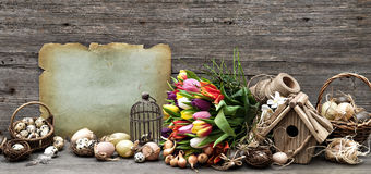 Nostalgic easter still life home interior. Vintage decoration with eggs and tulip flowers. wooden background stock photos