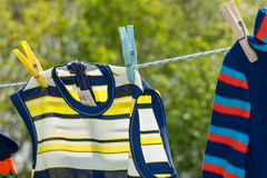 Nostalgic kids clothes on the line Stock Photography
