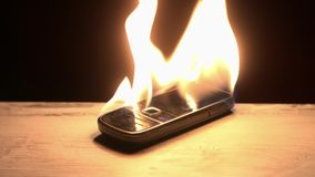 Nostalgic old cell phone burning stock video