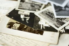 Nostalgic Old Photographs and Documents. Genealogy family history theme with old family photos and documents stock photos