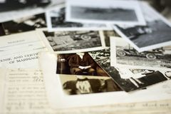 Nostalgic Old Photographs and Documents. Genealogy family history theme with old family photos and documents royalty free stock images