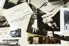 Nostalgic Old Photographs and Documents. Genealogy family history theme with old family photos and documents royalty free stock photography