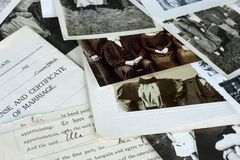 Nostalgic Old Photographs and Documents. Genealogy family history theme with old family photos and documents stock photo