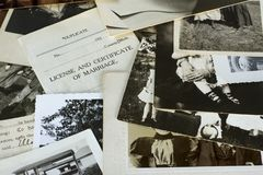 Nostalgic Old Photographs and Documents. Genealogy family history theme with old family photos and documents royalty free stock photo