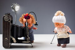 Nostalgic photographic moment with dolls Stock Images