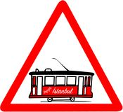 Nostalgic red tramway red triangular road sign warning. The Istanbul nostalgic tramways are two heritage tramlines in the city of Istanbul, Turkey Royalty Free Stock Photo
