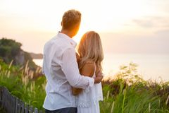 Nostalgic and romantic couple looking at sunset Royalty Free Stock Image