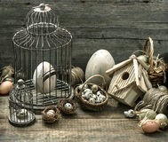 Nostalgic still life easter home interior. Vintage easter decoration with eggs, birdhouse and birdcage. nostalgic still life home interior. wooden background royalty free stock photo