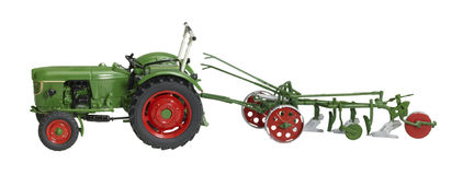 Nostalgic toy tractor with plowshare Stock Images