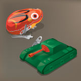 Nostalgic toys: Tin-plate frog and tank Stock Photography