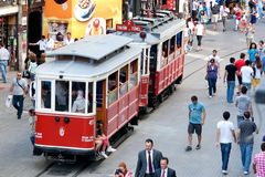 Nostalgic trams of Beyoglu, Istanbul. People enjoy themselves at Istiklal Street on July 06, 2010 in Istanbul. Istiklal St. is one of busiest shopping street in royalty free stock photos