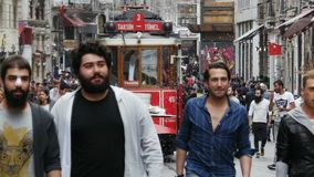 Nostalgic tramway passing through Istiklal Street stock footage