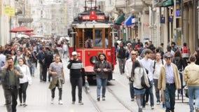 Nostalgic tramway passing through Istiklal Street stock video footage