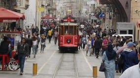 Nostalgic tramway passing through Istiklal Street stock video