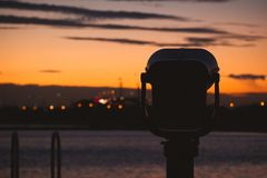 Nostalgic twilight with binoculars royalty free stock photos