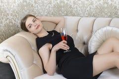 Nostalgic Woman Relaxing on Sofa Stock Photography