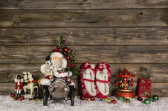 Nostalgic wooden christmas decoration with old children toys on Stock Photo