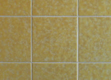 Nostalgic yellow wall tiles from the seventies. Indoor picture of nostalgic yellow wall tiles from the seventies Stock Photo