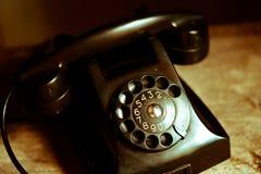 Nostalgin av appeller med gamla telefoner Arkivbilder