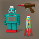 Nostalgische Spielwaren: Roboter, Raumschiff und Laser-Gewehr Lizenzfreie Stockfotografie