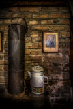 Nostalgy. An old furnace with a jug and an old photograph Stock Photos
