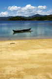 Nosy be  madagascarrock stone branch boat Stock Photography