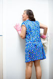 Nosy cleaning lady Stock Photo