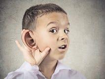 Nosy little boy, man listening carefully to someone's secrets. Closeup portrait, headshot boy, little man overhearing something, hand to big ear gesture, very Stock Photography