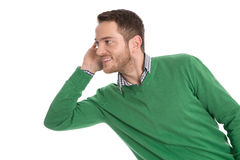 Nosy man isolated listening sideways on white. Stock Photo