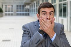 Nosy man reacting after getting a gossip Royalty Free Stock Photos