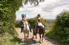 Nosy Riders. Two horse riders being nosy Royalty Free Stock Photos