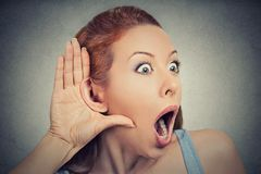 Nosy shocked woman listening eavesdropping Stock Photos